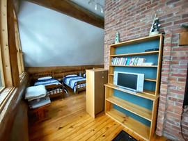 Bookshelf between two second floor bedrooms