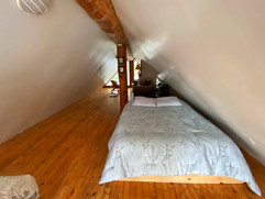 Queen size bed in loft