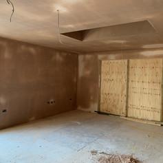 Fully plastered room in Radlett for Griggs Homes.