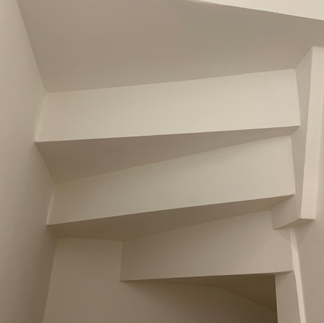 An unusual Ceiling underneath a staircase installed on our project in Chobham Farm for Higgins Construction.