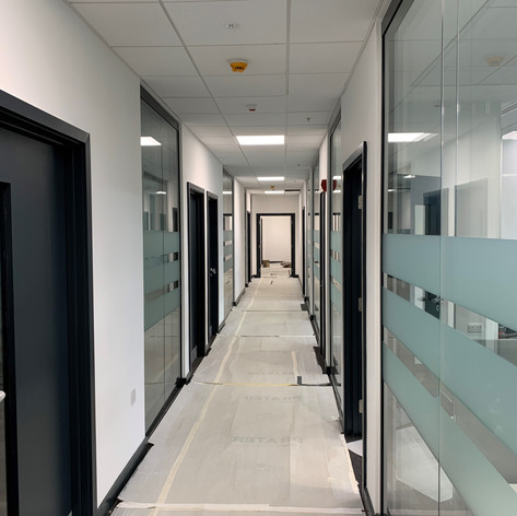 A completed hallway on our project at Gatwick Aiport for John Sisk & Son.