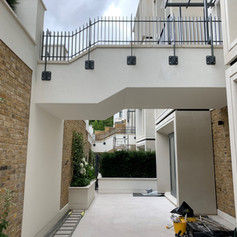 Render applied to the foot bridge on our project for Knight Build Ltd in Holland Park, West London.