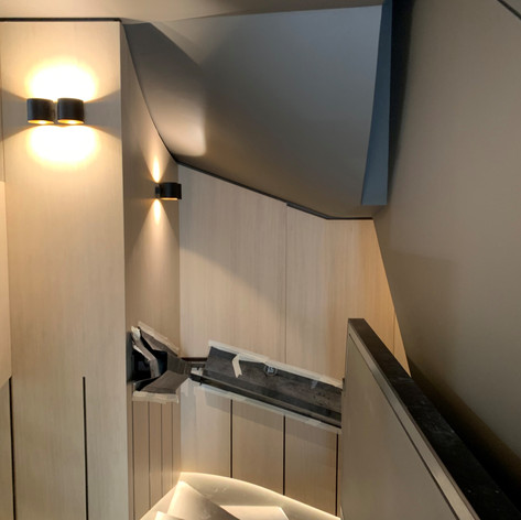 Fully installed curved ceiling under a staircase on our project in Regents Park for Red Construction.