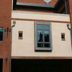 Render complete in line with brickwork at the rear of Hendon Majistrates.