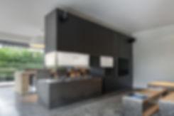 Room divider fireplace surround by Atelier Morrissette. Modern design.