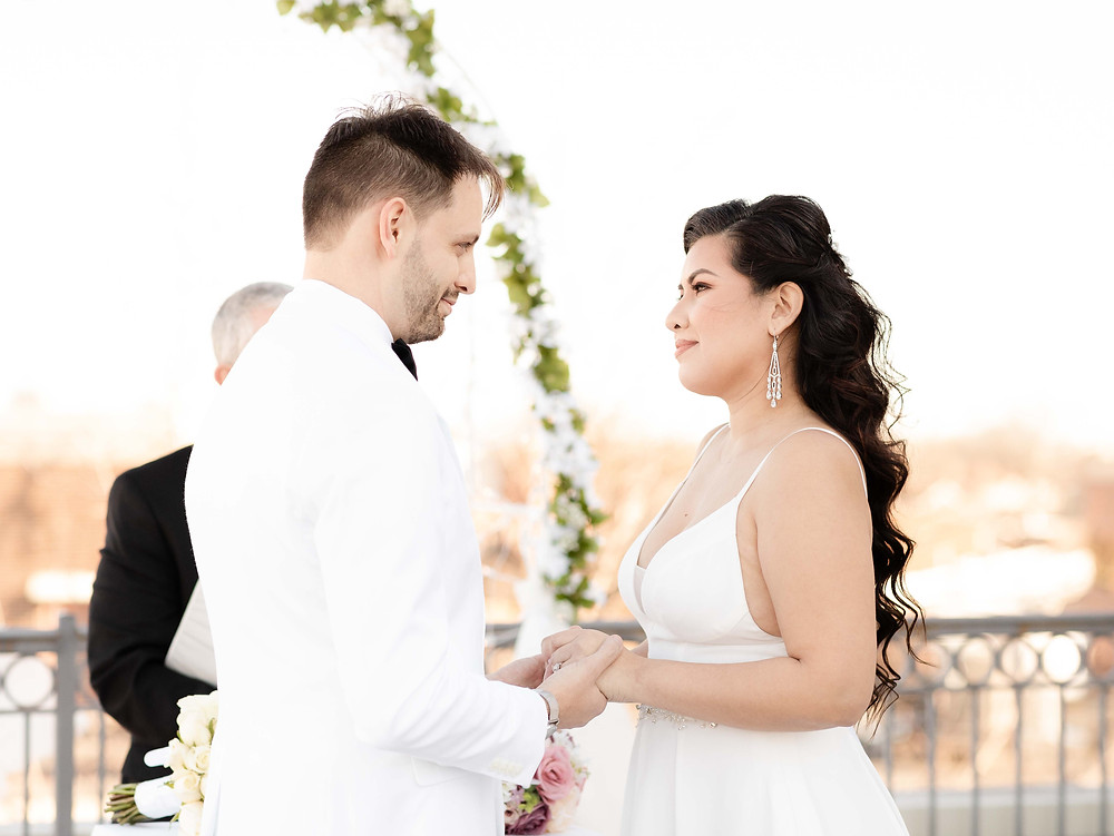 Wedding photography at Lorien Hotel and Spa in Old Town Alexandria. Couple says wedding vows.