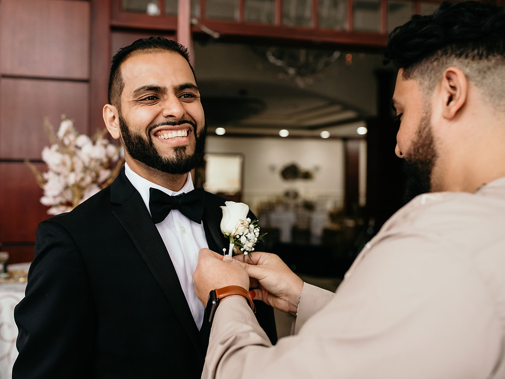 Groom getting ready for wedding day at Cherry Blossom Banquet Hall in Virginia.