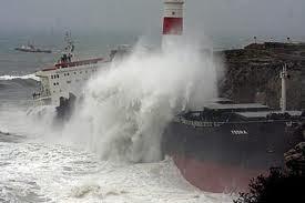 Wave hitting ship and shore