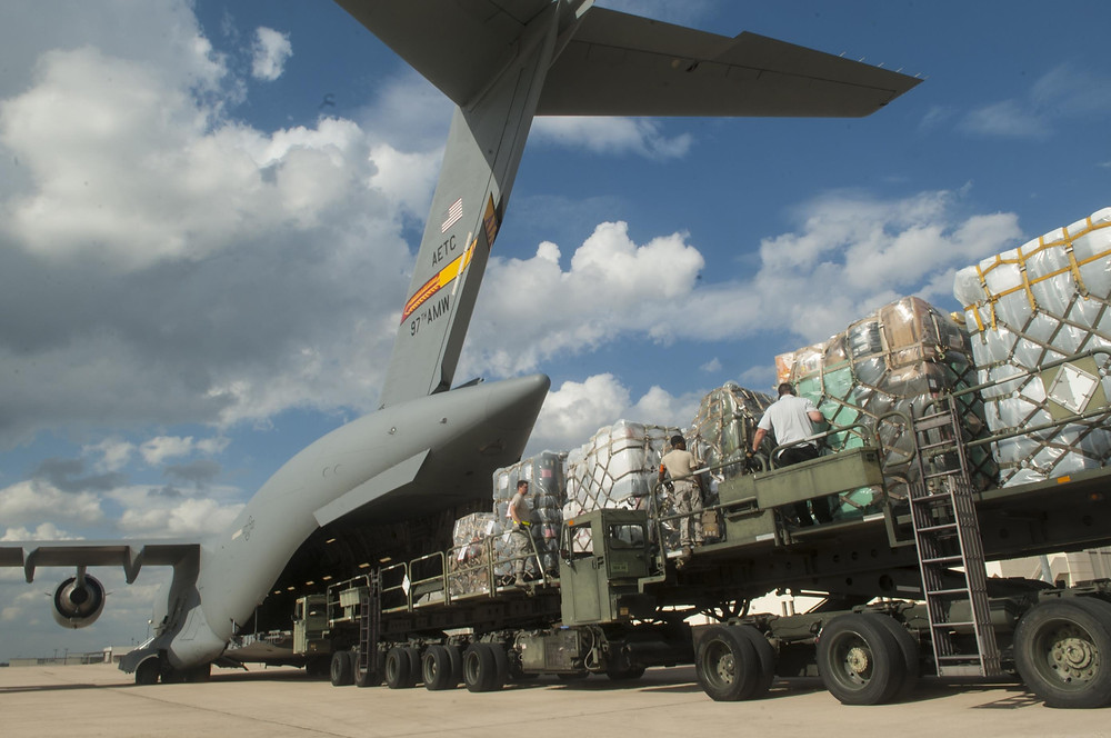 Medical supplies from the Air Force Medical Operations Agency are loaded onto a C-17 Globemaster III