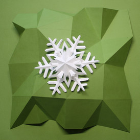 Snowflake on faceted paper