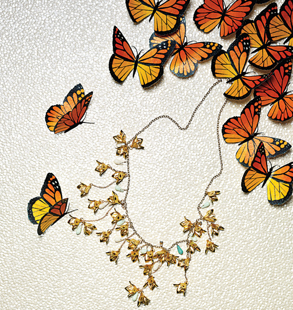 Monarchs flying away with a necklace