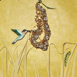 Hummingbird, caterpillar, and necklace