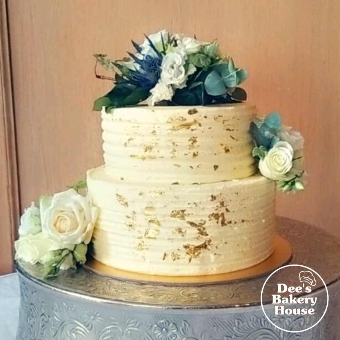 2 tier buttercream with gold leaf weddin