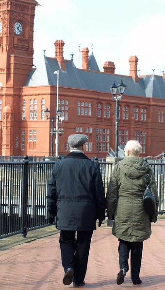 Older couple walking in Cardiff Bay