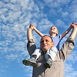 Man with son on shoulders