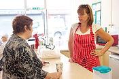 Volunteer and customer in Senior Health Shop