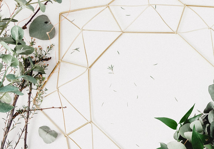 I used some leftover foliage from a photo shoot to style this gold metal geometric wreath from Hobby