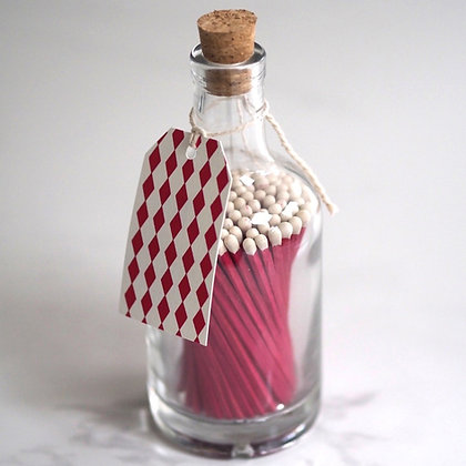 Pink bottle of matches