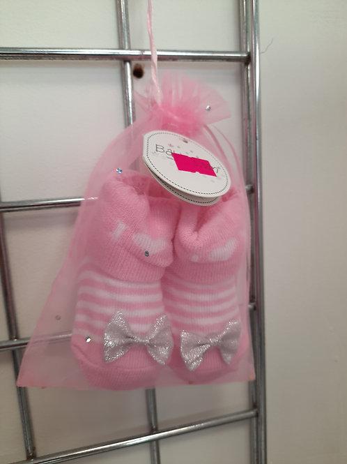 Beautiful newborn socks with bow in gift bag