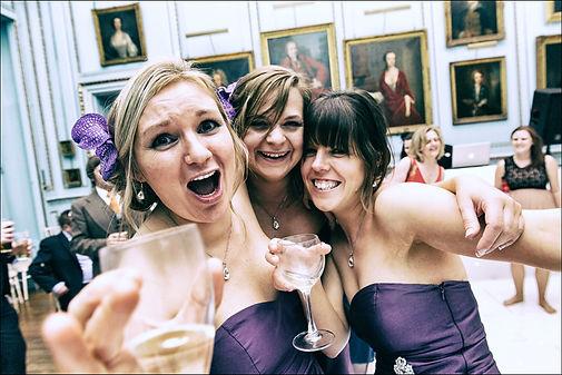 Bridesmaids having fun and enjoying a glass