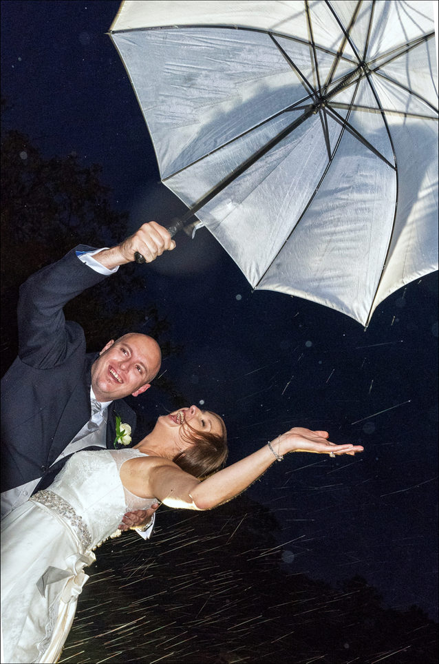 Bride and groom party in the rain