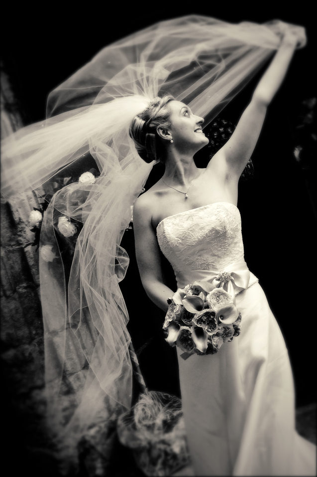 Bride holds tight in the wind