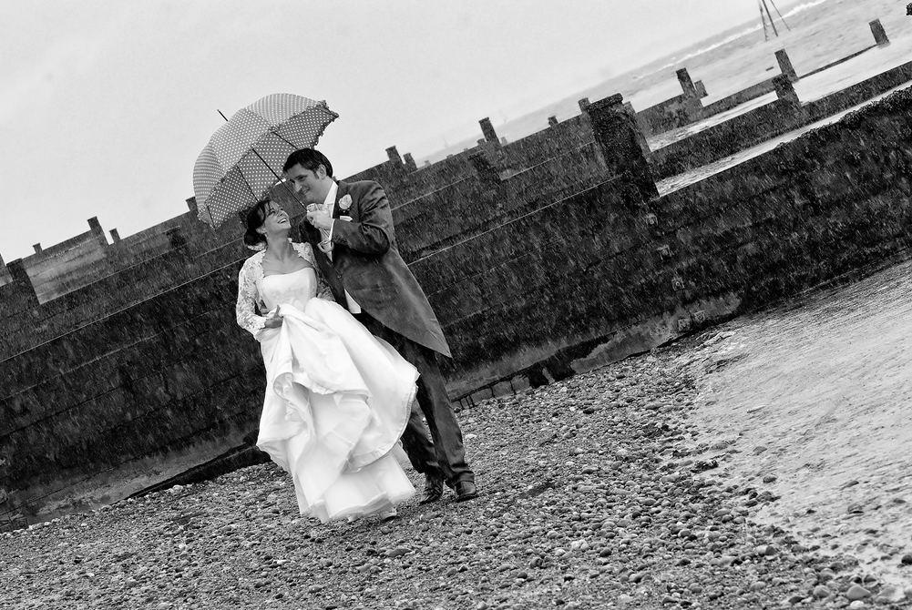 Wedding couple walk along the beach