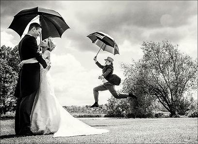 Heavy rain at wedding run for cover!