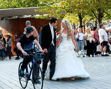 Bride and groom walk in London