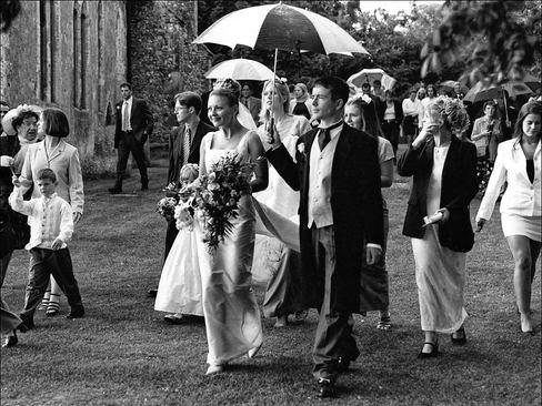 Wedding couple walk proudly