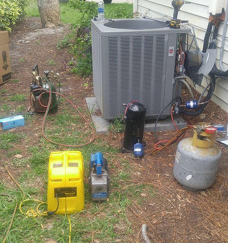 AC compressor replacement in progress