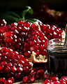 Homemade pomegranate jam in a glass jar