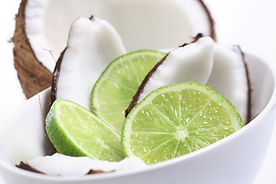 Coconuts and lime in white bowl .jpg