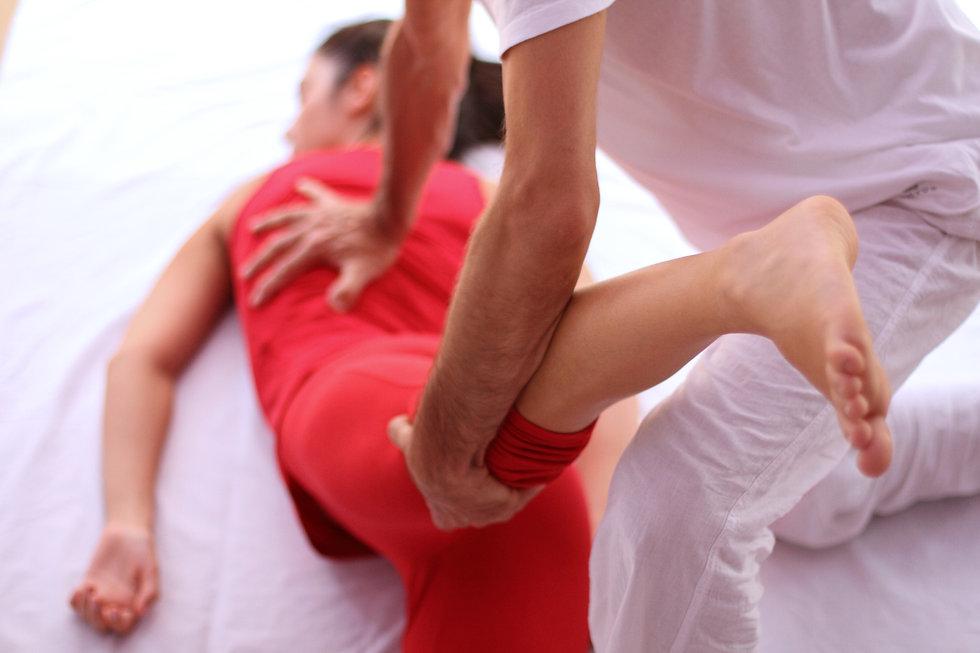 Shiatsu back and leg massage on female p