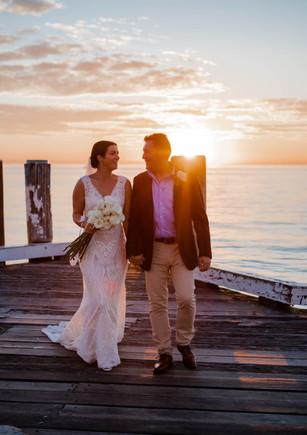Kelly & John sunset at Tangalooma