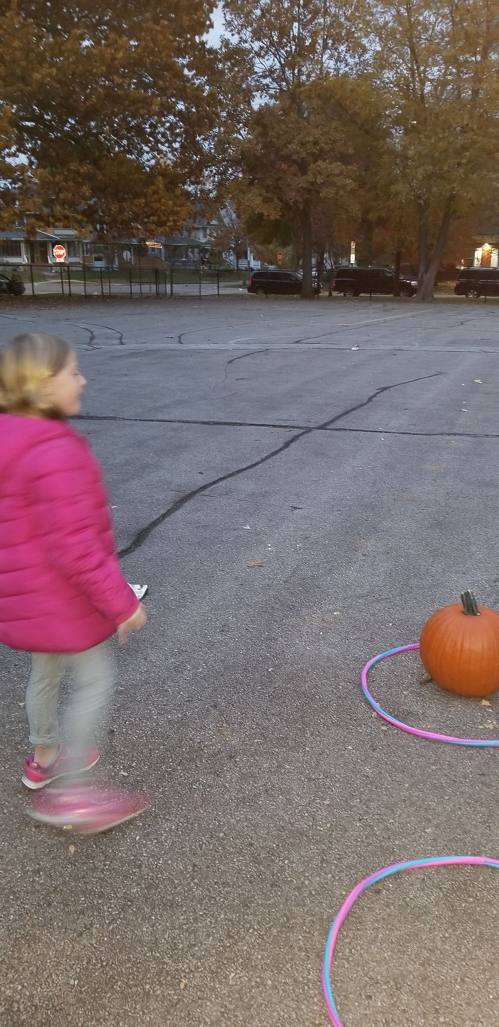 picture of a girl on the left with a pumpkin on the right for a pumpkin themed ring toss