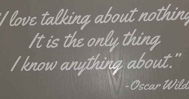 "Quote on a gray door. ""I love talking about nothing. It is the only thing I know anything about.""-Oscar Wilde"