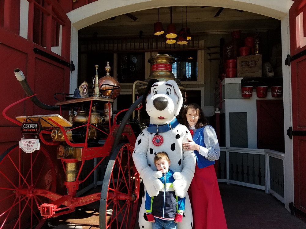 Vintage Fire Truck at Silver Dollar City, Lucky the Rescue Dog, and his guide at Silver Dollar City in Branson, Missouri