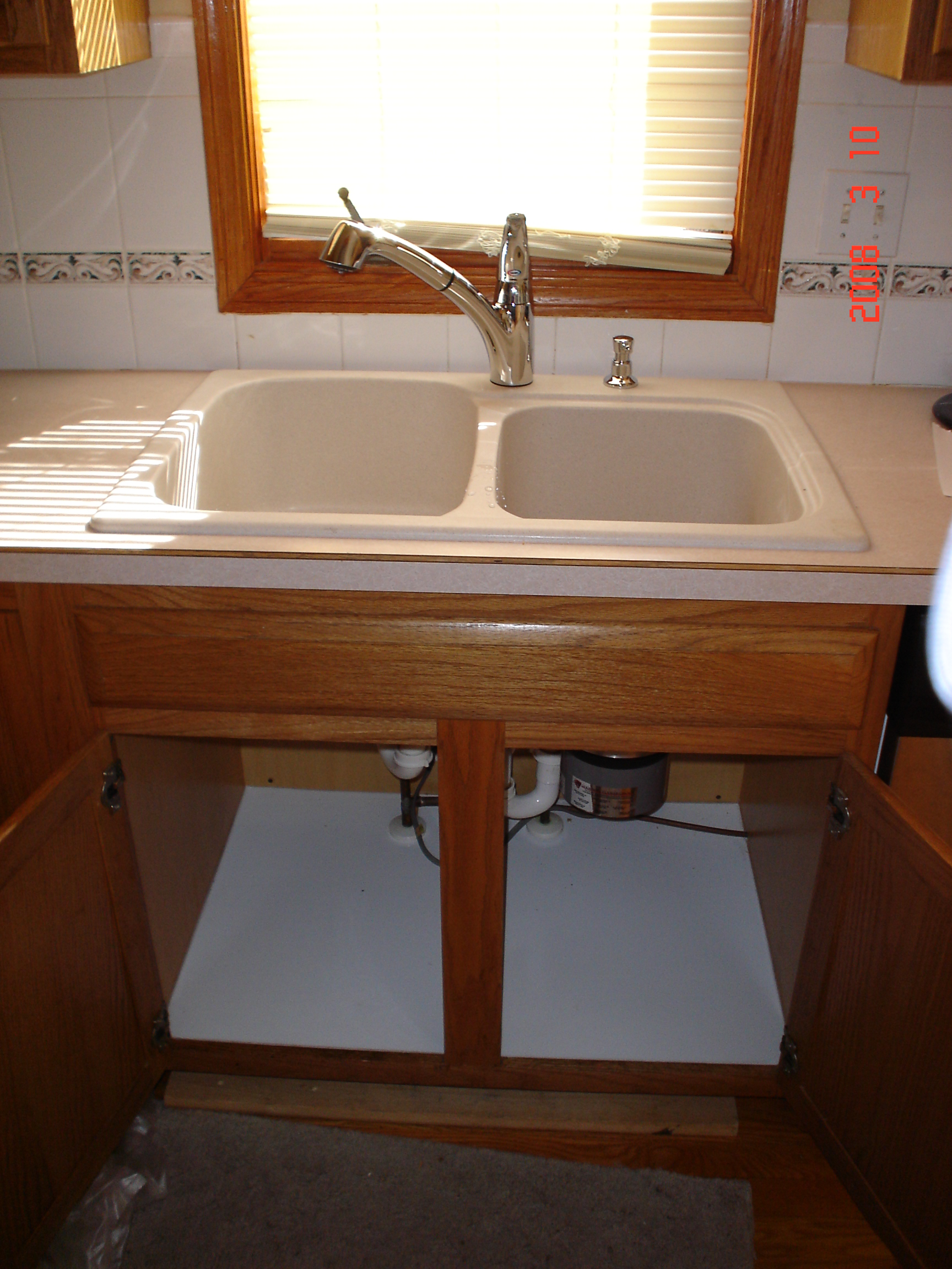 Sink, Faucet, Cabinet Floor Replaced