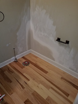 Wall fixed & new hardwood replaced