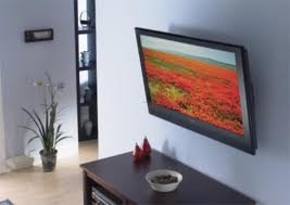 Flatscreen TV mounted on wood or drywall