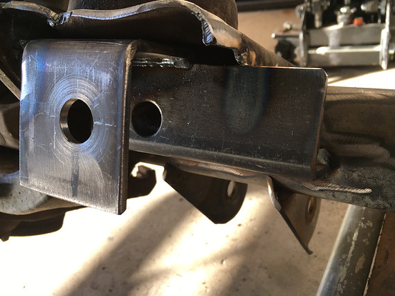 "The stock trackbar bushing was seized to the bolt so we decided to cut the bracket off and build a new one out of 3/16"" plate. Much stronger and gives the trackbar more clearance."