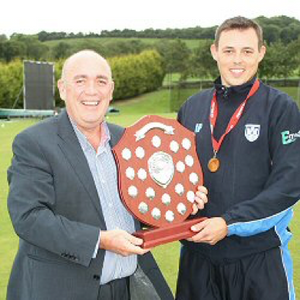 Skipper, Iain Parkhill, receives O'Neill's Ulster Shield from Managing Director of sponsors