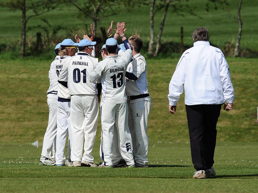 1st XI celebrate a wicket