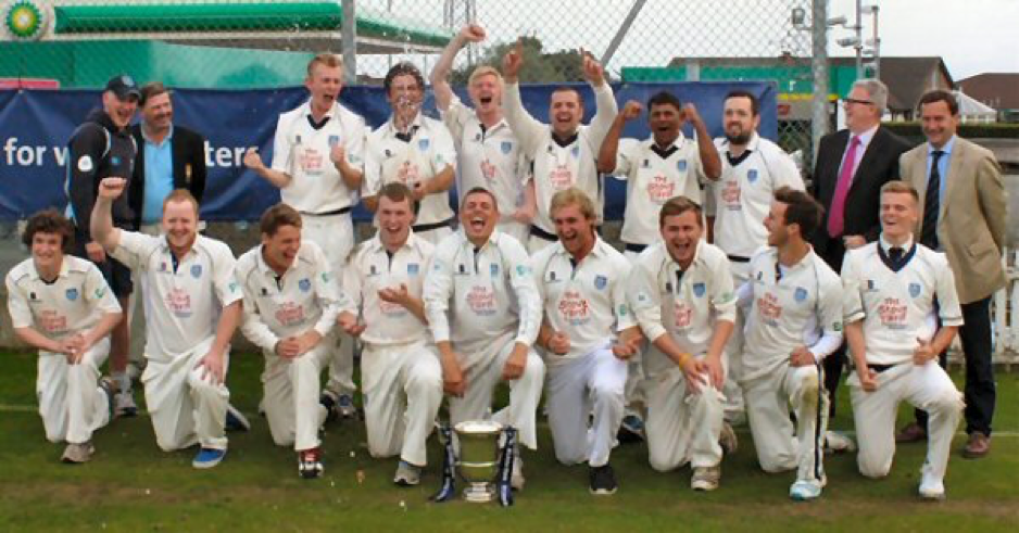 The winning team, pictured celebrating the Section One League victory.