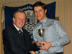 CricketIreland President Richard Johnson presents Ryan Eagleson with the Cricketer of the Year Trophy