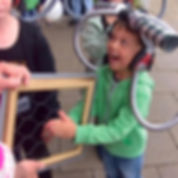 Child doing a science busking trick