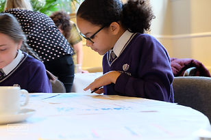 School pupil working at a table