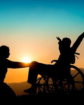 happy-boy-wheelchair-sister-sunset-happy