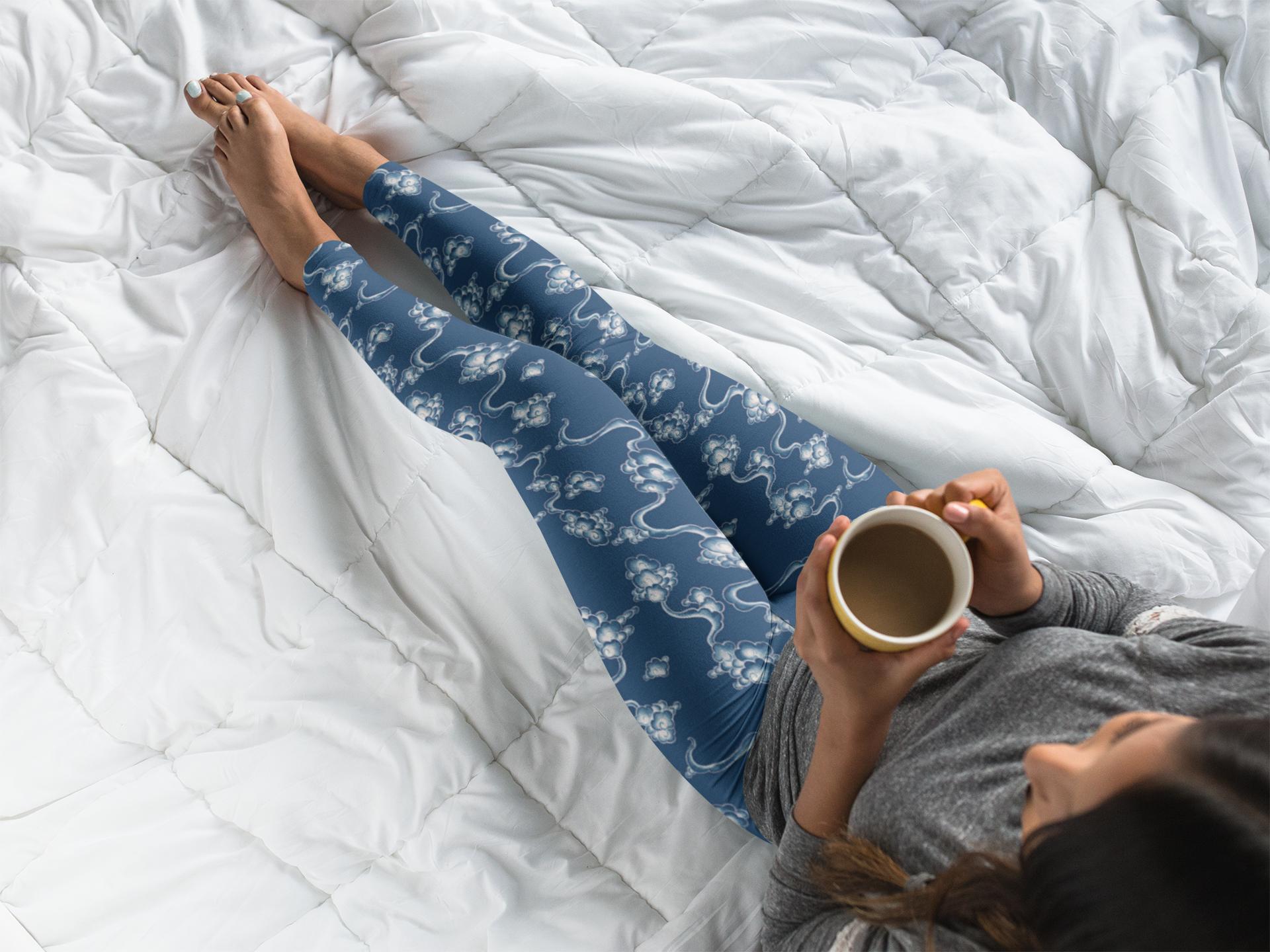 Blue Blue Mist Leggings on Bed.png